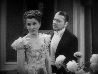 "Jane (Diana Wynyard) and Robert Marryot (Clive Brook) are ready to ring in the 1900s in the 1933 Best Picture winner ""Cavalcade."""