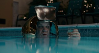"Dean ""Deanzie"" Ziegler (John C. Reilly) proclaims himself Captain Nemo as he wears a garbage can cover as a helmet in a rule-breaking late night pool dip."