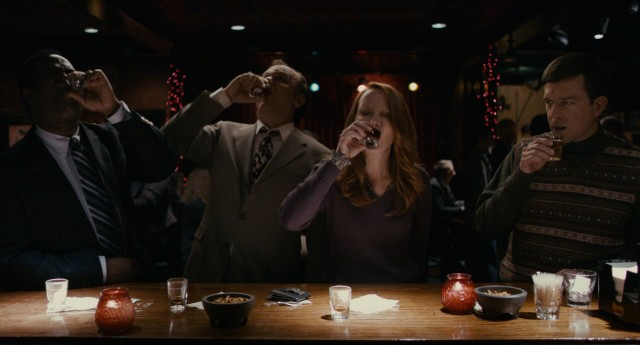 As his new friends Ron, Dean, and Joan down their shots, Tim Lippe (Ed Helms) takes a sip.