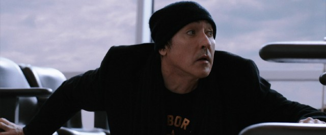 "Graphic novelist Clay Riddell (John Cusack) is at the Boston airport when things go strange in ""Cell."""