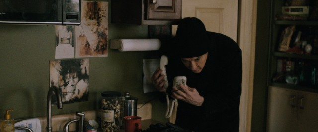 "Could landlines save the day in ""Cell""? Clay Riddell (John Cusack) hopes so."