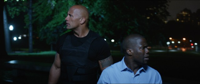 "Bob (Dwayne Johnson) and Calvin (Kevin Hart) await the exchange of security codes for money in one of the climaxes of #109, ""Central Intelligence."""