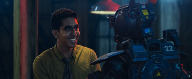 Deon Wilson (Dev Patel) is delighted to see some fruits from his years of secret, after-hours home labor in the form of sentient robot Chappie.