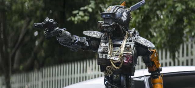 "Chappie sets out to be Robot Gangster Number One in Neill Blomkamp's ""Chappie."""