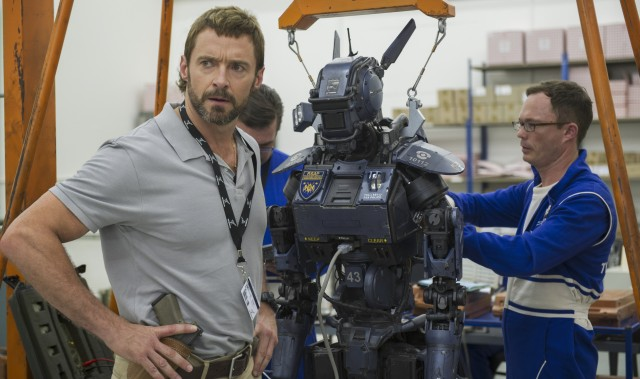 "Hugh Jackman sports an unfortunate mullet in ""Chappie"" and he's not the only one."