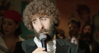 Jason Schwartzman sports a curly Afro and a thick beard as singer/comedian Kirby Star in a film by his first cousin Roman Coppola.