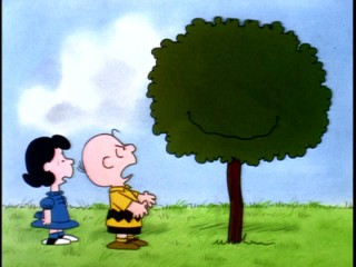 Charlie Brown is not happy with the smiling tree that just ate his kite.