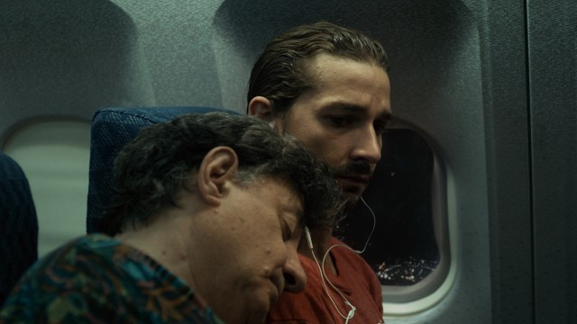 Shia LaBeouf plays Charlie Countryman, an American whose flight neighbor (Ian Caramitru) sleeps on his shoulder and then dies next to him on their shared flight to Bucharest.