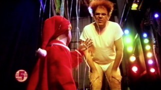Dreaming at a marinara pruppet theater, an underwear-clad Steve Brule (John C. Reilly) is led by a small boy puppet.