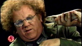 "Dr. Brule doesn't seem to want a lizard kiss in ""Animals."""