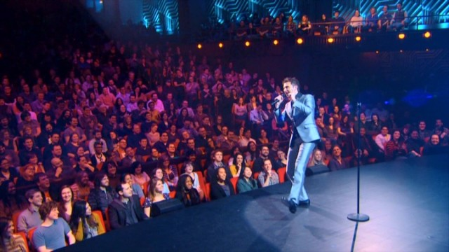 "Chris Hardwick entertains a small, pink-tinted, non-paying audience of 800 at NYU's Skirball Center in his Comedy Central special ""Mandroid."""