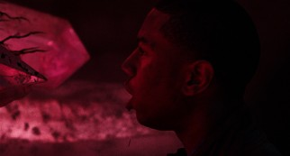 A bleeding Steve (Michael B. Jordan) discovers that glow sticks aren't the only luminescent object on the night of the rave.