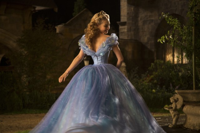 "Cinderella (Lily James) admires the dress her fairy godmother has made over for her in Disney's 2015 live-action ""Cinderella."""