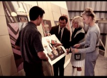 Mary Blair shows off some of her striking art design to three friends.