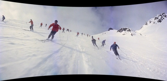 "Swiss skiers come downhill towards you in ""Cinerama Holiday."""