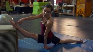 Erica Linz reminds us that stretching is important even for limber acrobats.