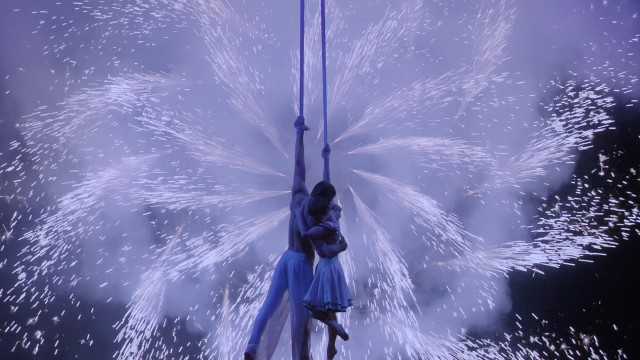 Pinwheel fireworks serve as a dynamic backdrop to The Aerialist and Mia's inevitable happy ending.