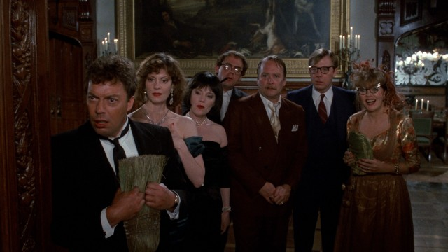 "The seven ""Clue"" leads (Tim Curry, Lesley Ann Warren, Madeline Kahn, Christopher Lloyd, Martin Mull, Michael McKean, and Eileen Brennan) try to respond casually to an inquiring police officer."