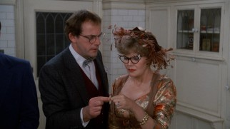 Professor Plum (Christopher Lloyd) and Mrs. Peacock (Eileen Brennan) draw matching matches, meaning they'll explore part of the mansion together.