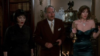 With randomly assigned lethal weapons in hand, Mrs. White (Madeline Kahn), Colonel Mustard (Martin Mull), and Miss Scarlet (Lesley Ann Warren) have a fright.