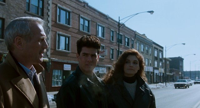 For a 60% cut of their winnings, Fast Eddie Felson (Paul Newman) shares some of his hustling wisdom with young couple Vincent Lauria (Tom Cruise) and Carmen (Mary Elizabeth Mastrantonio) on a chilly road trip.