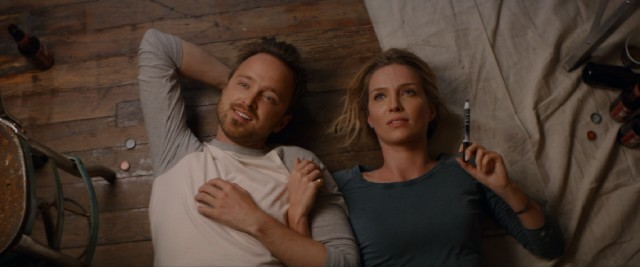 "Happier times: David (Aaron Paul) and ""Claire"" (Annabelle Wallis) admire her marker handiwork on the ceiling of their new place."