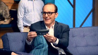 "Clark Gregg proudly displays a stapler he stole from the set of ""Iron Man."""