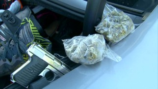 A Stockton, California car search turns up guns and drugs.