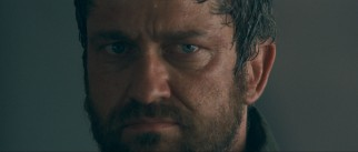 Coriolanus' blood enemy Tullus Aufidius (Gerard Butler) shoots him a menacing look before their one-on-one knife fight begins.