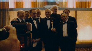 Surrounded by alumni of The Corman Film School and honorary graduate Quentin Tarantino, Roger Corman proudly holds his lifetime achievement Oscar.