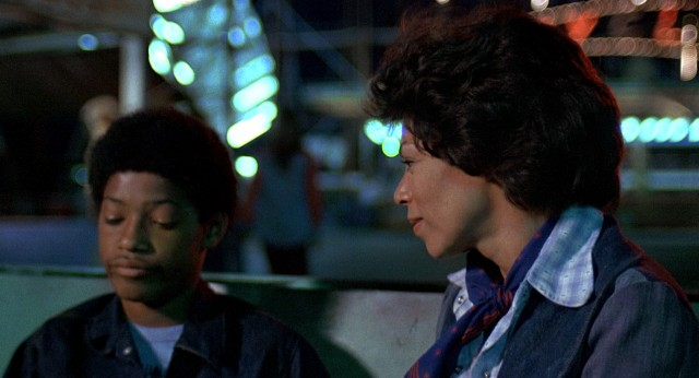 Wilford's mother (Rosalind Cash) struggles to cheer up the boy (Laurence Fishburne) after his hero is killed.
