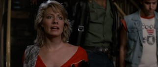 In the closing scene of the original film, Sue (Linda Kozlowski) chases Mick to a crowded subway platform, where she professes her love for him.