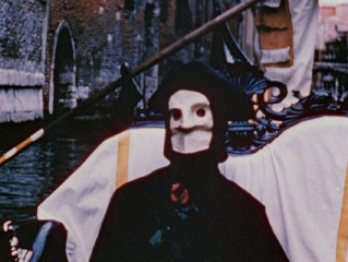 "A masked man with a rose takes a boat ride around Venice's canals in Curtis Harrington's 1953 color short ""The Assignation."""