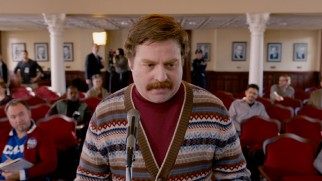 "Local tour guide Marty Huggins (Zach Galifianakis) surprises everyone with his candidacy announcement in ""The Campaign."""