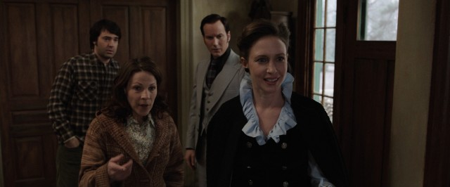 "Carolyn Perron (Lili Taylor) introduces Lorraine Warren (Vera Farmiga) to her five daughters in ""The Conjuring."""