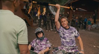 Camp Canola's head (Lochlyn Munro) and his young, coordinated charge (Sean Patrick Flaherty) try their intimidation tactics in lavender camouflage.