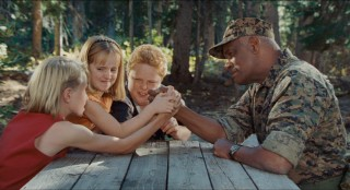 Mullet Head (Zachery Allen), Becca (Molly Jepson), and Billy (Tyger Rawlings) outnumber in an attempt to out-arm-wrestle Colonel Hinton (Richard Gant).
