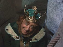 The clever leprechaun king looks up out of his bag.