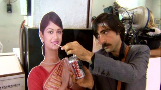 "Jason Schwartzman shares a sip of his Coca Cola Light can with a cardboard woman in ""The Making of 'The Darjeeling Limited.'"""