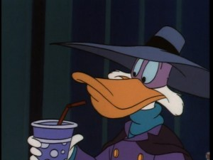It may look like Darkwing's slacking off while on duty, but he's actually following a lead.