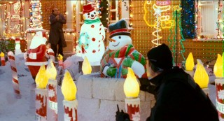 With Buddy looking on, Steve bobs along with an animated snowman in a covert effort to off the Halls' lights.