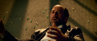 Creepy undercover cop Chuck Dooney (Elias Koteas) falls victim to the first line of Defendor weaponry: marbles.