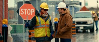 Arthur (Woody Harrelson) would be much less tired and bruised at his day job if Hammertown's criminals only needed a stop sign like construction zone drivers. Though he looks confrontational here, Arthur's foreman (Michael Kelly) is his one friend.