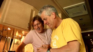 "On the bus in ""Snapshots from the Road"", Denis Leary ribs pal, tour mate, and onscreen uncle Lenny Clarke for vowing he'd sell his soul for the tiny pudding cup he holds."