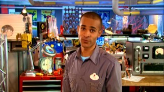 Amusing host Imagineer Asa Kalama stands and teaches from this busy, colorful laboratory room.