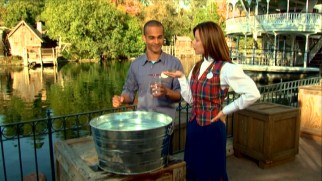A Disney cast member has just what Asa Kalama needs to demonstrate the displacement of water in front of the Mark Twain Riverboat.