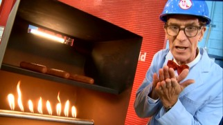 Bill Nye the Science Guy uses hot dogs cooking in ovens to explain different types of heat transfer.