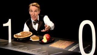 Bill Nye shows off some of the wonderful fractions existing between 0 and 1, like a piece of pumpkin pie, a bite of an apple, and change.