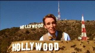 Bill Nye stands between the famed Hollywood sign and a scale model of it in a Pre-Algebra segment teaching proportions.