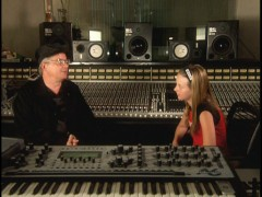 "Nicole, the lead vocalist for DEVO 2.0, speaks with Mark Mothersbaugh, the lead vocalist of the original DEVO, in the featurette ""Original De-evolutionists."""